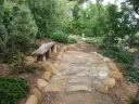 formerly grass, now log bench and small terrace along upper level path